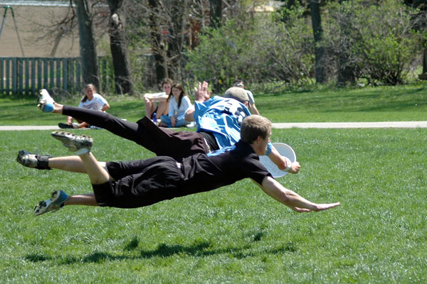 Ultimate players diving for a catch